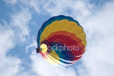 ist2_2032250-hot-air-balloon-amidst-clouds