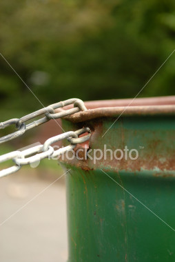 ist2_2162612-chained-garbage-can-portrait