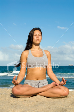 ist2_5546601-mediation-on-the-beach-yoga-lotus-position